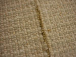 Damaged Woven Carpet during Re-Stretch
